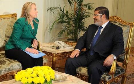 Mursi dan Hillary Clinton